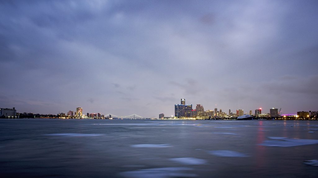 Detroit and Windsor skyline on a cloudy day.