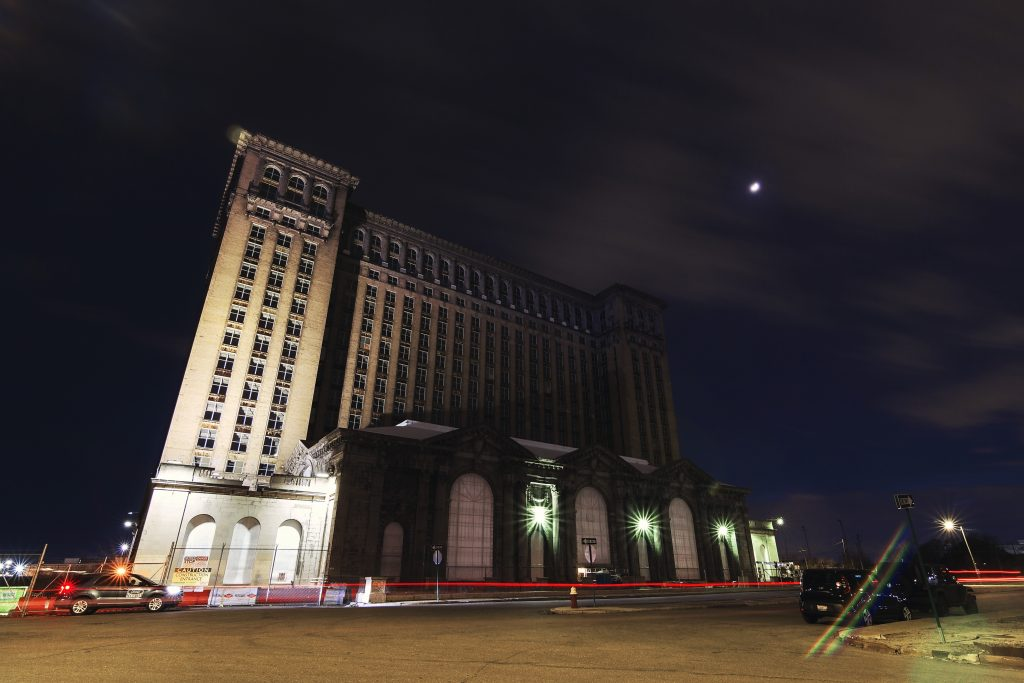 The Michigan Central train station at night.