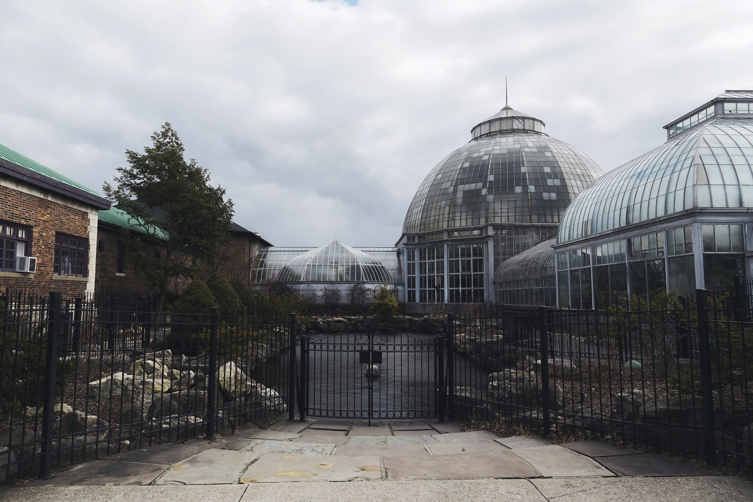 An entrance to the gated courtyard of the conservatory